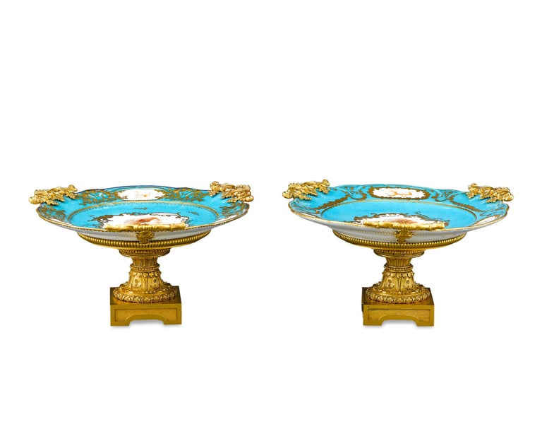 Two excellent Sèvres porcelain plates are mounted in bronze ormolu stands in these exceptional compotes. The delicate turquoise, or bleu celeste, hue provides the perfect background to exquisite portrait plaques of two ladies, surrounded by smaller