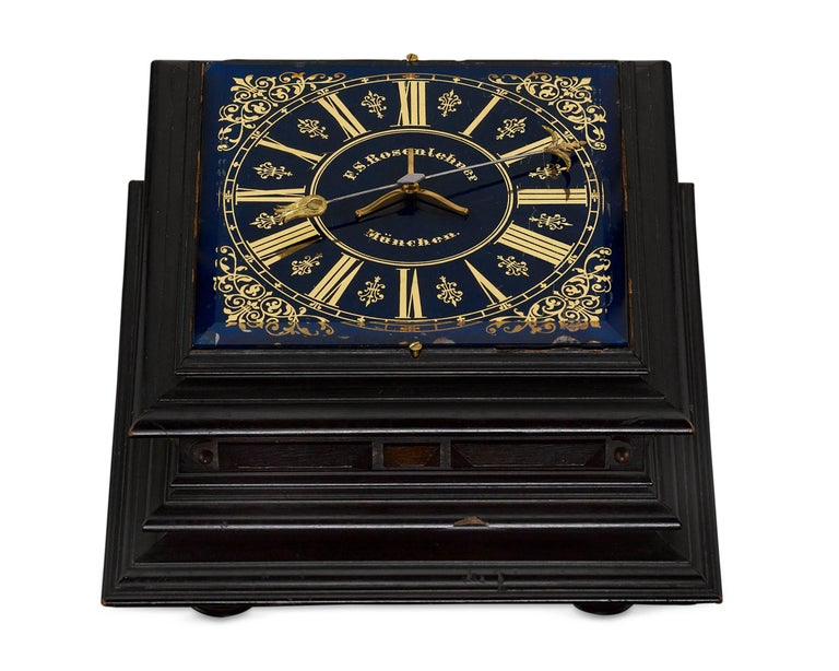 An incredibly rare 19th century horizontal table mystery clock with single hand by German clockmaker F.S. Rosenlehner of Munich. This fascinating antique timepiece features a free wielding hand that rotates upon a fixed point in the centre of a