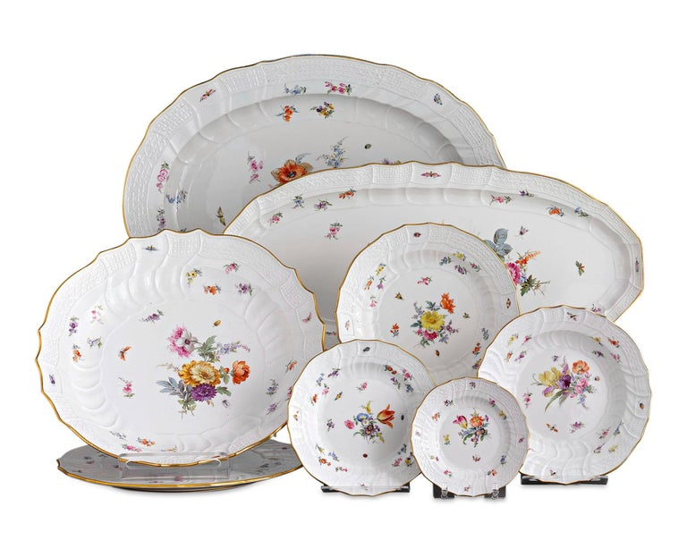 Comprising an incredible 184 pieces, this impressive Meissen porcelain dinner service is an exceptional example of the firm's prized dinnerware. The bodies are crafted in the New Brandenstein relief pattern designed by Johann Friedrich Eberlein in