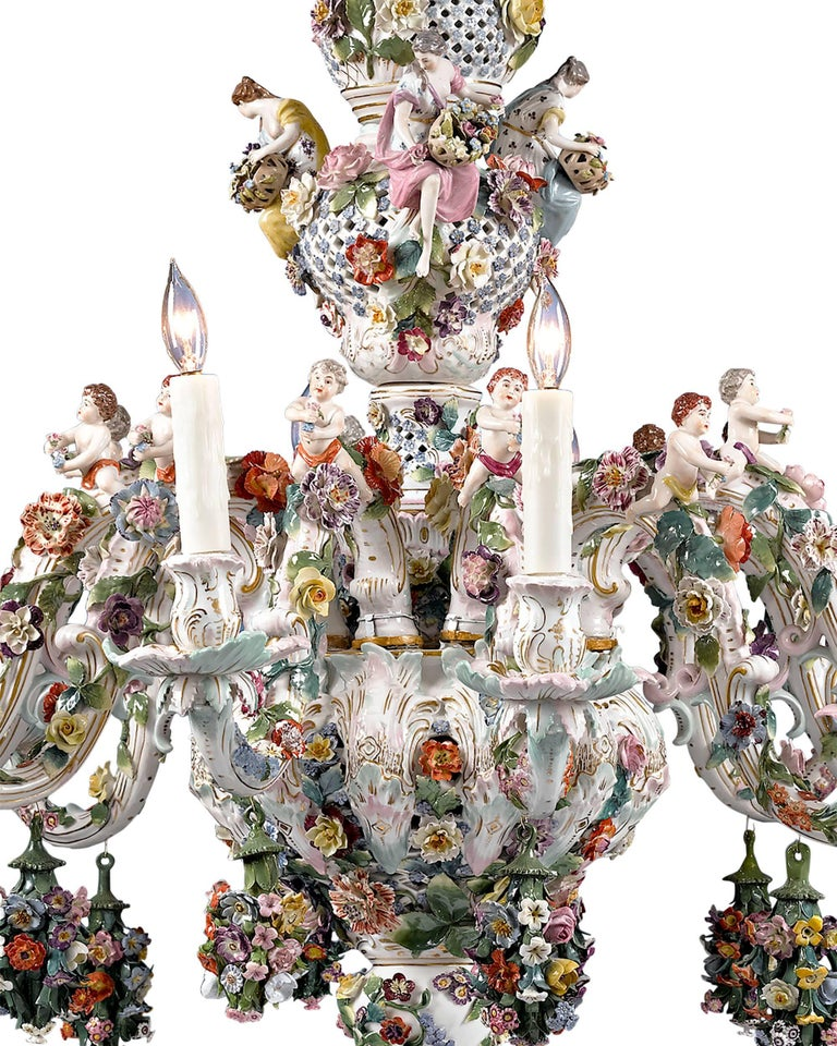 Blanketed in a multitude of floral bouquets, this monumental porcelain chandelier was crafted by Meissen. A marvellous example of the firm's exceptional artistry, this enchanting 12-light fixture exemplifies the Rococo style. Its lush garden motif