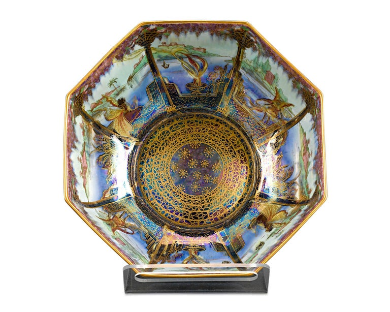 The exotic beauty of Wedgwood Fairyland Lustre is exemplified in this captivating octagonal bowl. Displaying the fantastical creativity for which Fairyland Lustre is so robustly collected, this magnificent bowl exhibits the stunning Moorish pattern