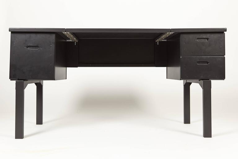 You are viewing a WWII Campaign desk that would have been used in the European and Pacific theater during the war. The desk is made from the same aluminum that was used for aircraft in the 1930s-1940s. The desk first started out with army green