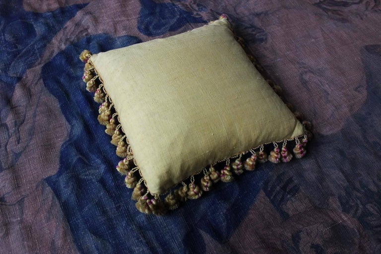 A fine and rare pair of 19th century French golden-yellow silk damask and fringe cushions, backed with 18th century burette (minor variations in size).
