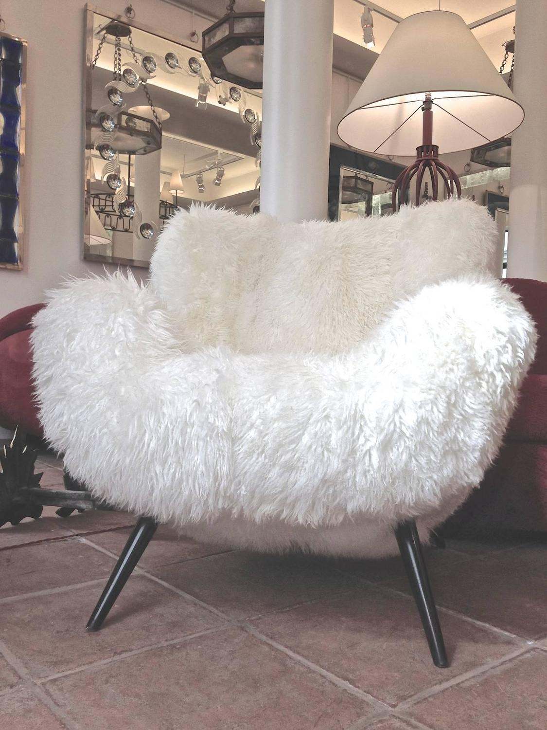 Fritz neth rarest spectacular wood legged lounge chairs covered in sheepskin fur for sale at 1stdibs