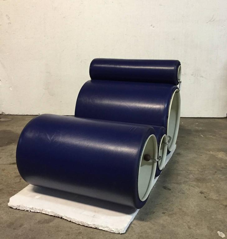 Modular chair with plastic tubes, foam and covered by a polyurethane coat.