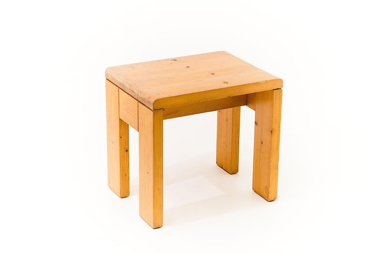This stool by Charlotte Perriand is in pine, in a blond color. This is from her last creation Period Minimalist. After she studied under the direction of Le Corbusier, she worked with him. Then she had a partnership with Jean Prouvé, to furnish an