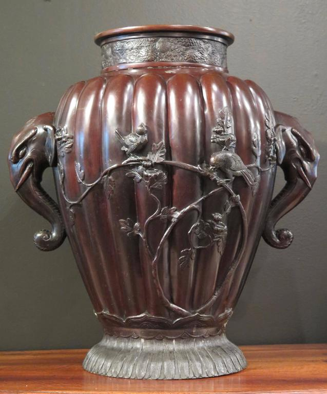 A very large Meiji period bronze vase, possibly for temple use, with high relief design and elephant head handles, late 19th century, Japan.   Of baluster form and unusual size, yet still retaining elegant proportions, the lobed body rising from a