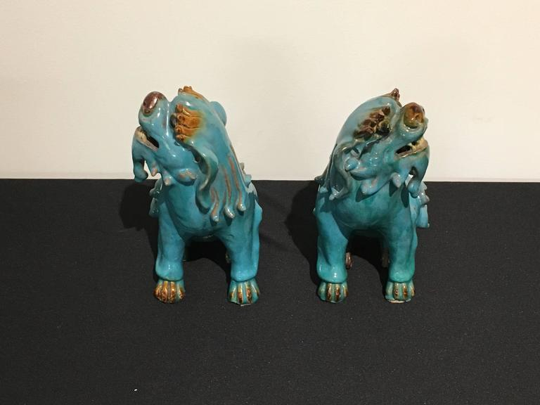 Pair of Chinese Turquoise Glazed Shiwan Pottery Foo Dogs In Good Condition For Sale In Austin, TX