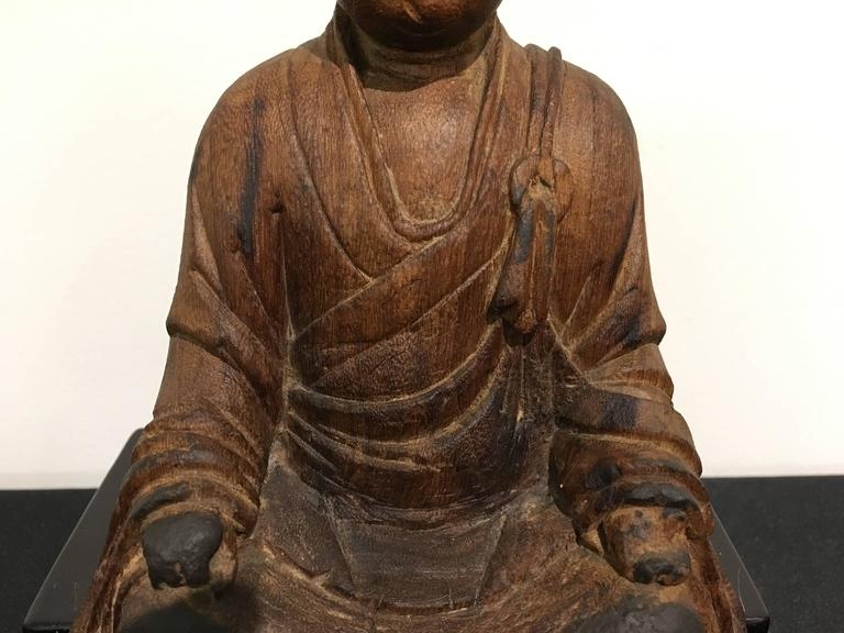 Chinese carved wood figure of ksitigarbha yuan dynasty