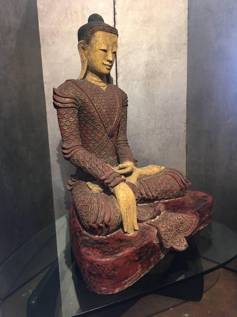An outstanding lifesize early 20th century Shan Burmese dry lacquer figure of the Buddha dressed in royal attire. The royal Buddha sits upon a raised platform is vajrasana, hands in bhumiprasha mudra, calling the earth to witness his enlightenment.
