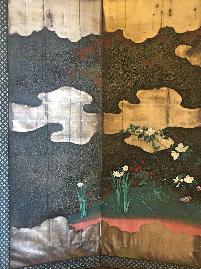 A stunning and rich Japanese six-panel folding screen, byobu, Edo Period, early 19th century. Painted in deep, vibrant colors, using mineral pigments, the scene depicts autumn flowers and foliage. A pair of quail huddle under a Japanese maple with