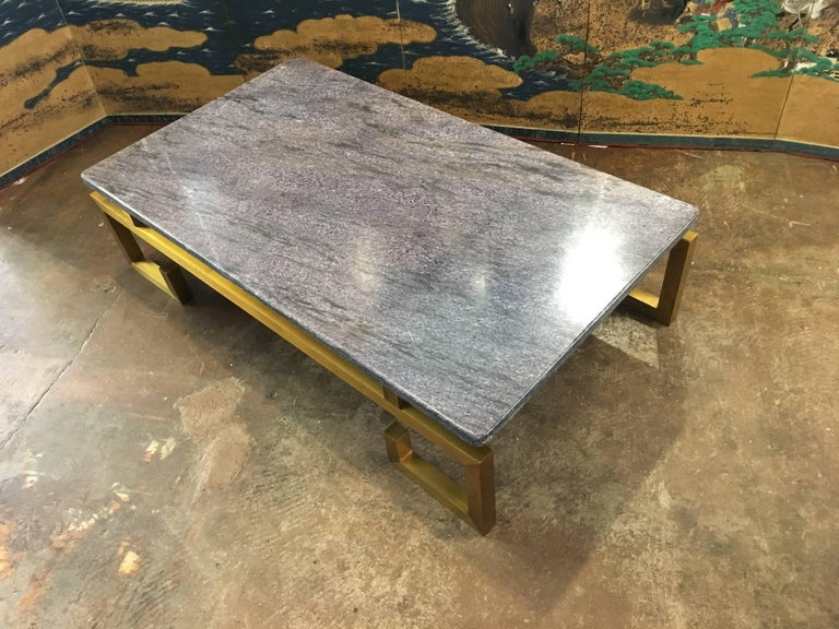 A stunning and chic French Modern coffee table in the style of Guy Lefevre and Maison Jansen, circa 1970s. 