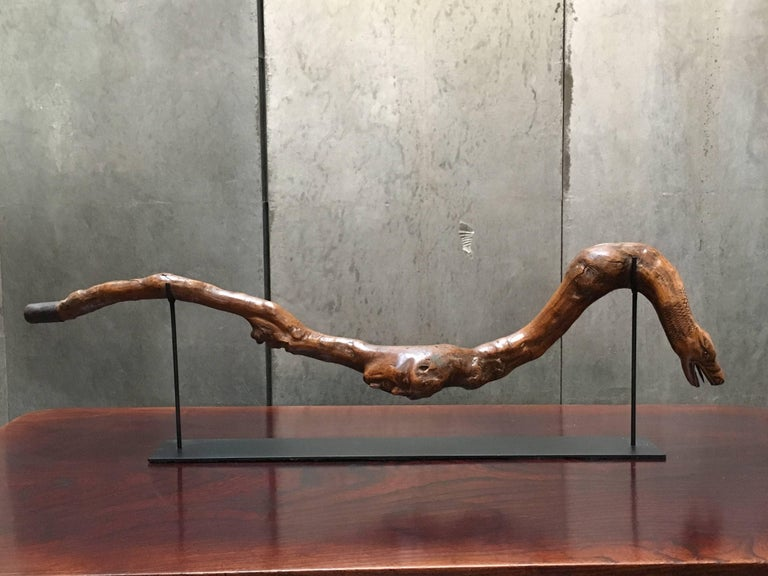 An intriguing early 20th century American folk carved walking stick, mounted as a sculpture.