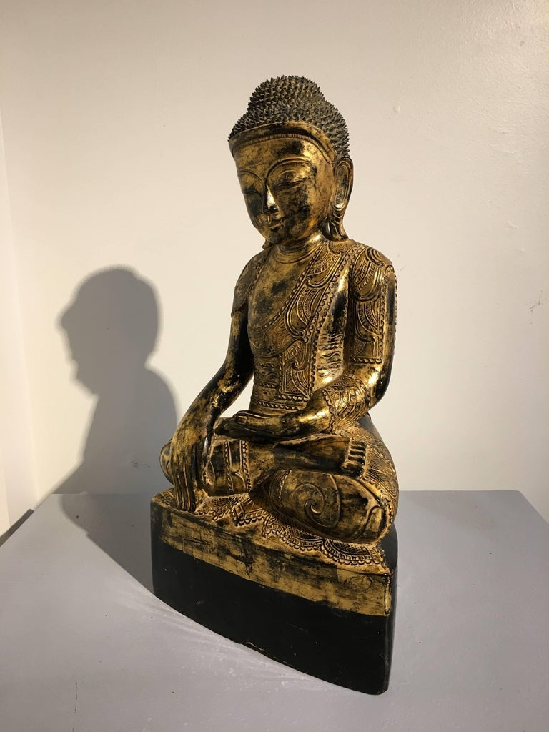 Hand-Carved Burmese Ava Period Carved, Lacquered and Giltwood Buddha, Late 18th Century For Sale