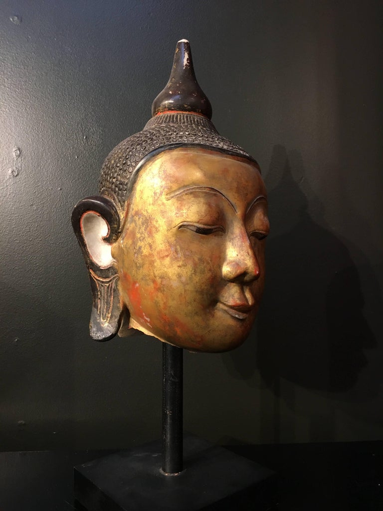 A large carved, lacquered and gilt Ava style marble head of the Buddha, Burma (now Myanmar), 17th century.