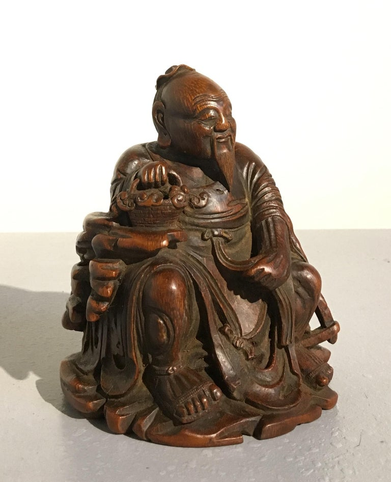 A sweet and lovely Chinese bamboo carving of the sage Dongfang Shuo, mid-Qing dynasty, 18th century.  Well carved form a single section of bamboo, the carving depicts the historical Han dynasty figure Dongfang Shuo. The sage, scholar, court