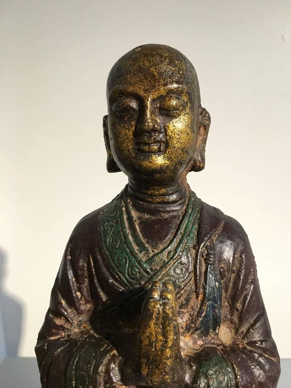 Ming Dynasty Polychrome Lacquer and Gilt Iron Figure of Ananda In Good Condition For Sale In Austin, TX
