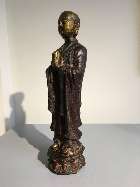 Cast Ming Dynasty Polychrome Lacquer and Gilt Iron Figure of Ananda For Sale