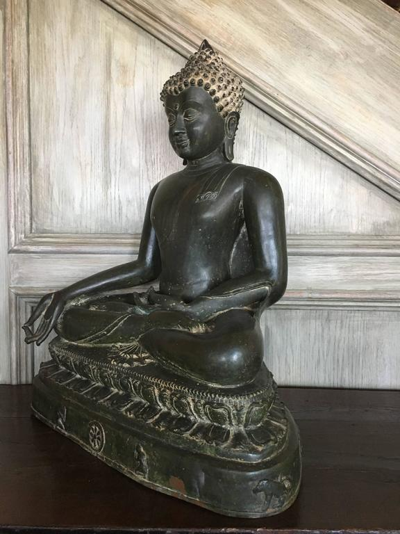 A large and magnificent cast bronze image of the Medicine Buddha, Bhaisajyaguru, rendered in the Burmese Pagan style, and most likely based on a period example that was either damaged or lost, 19th century, Burma or Thailand.    He can be identified
