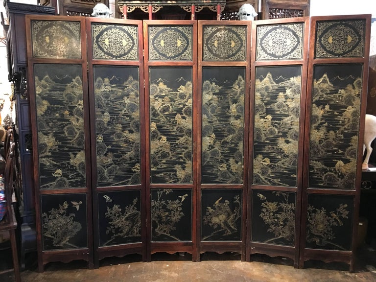 A very fine mid-Qing Dynasty Chinese hardwood and lacquer six-panel screen, Jailing Period, circa 1800.  The hardwood frame inset with black lacquer panels. One side features an overlay of jade, hardstone, coral, and wood in the Hundred Antiques
