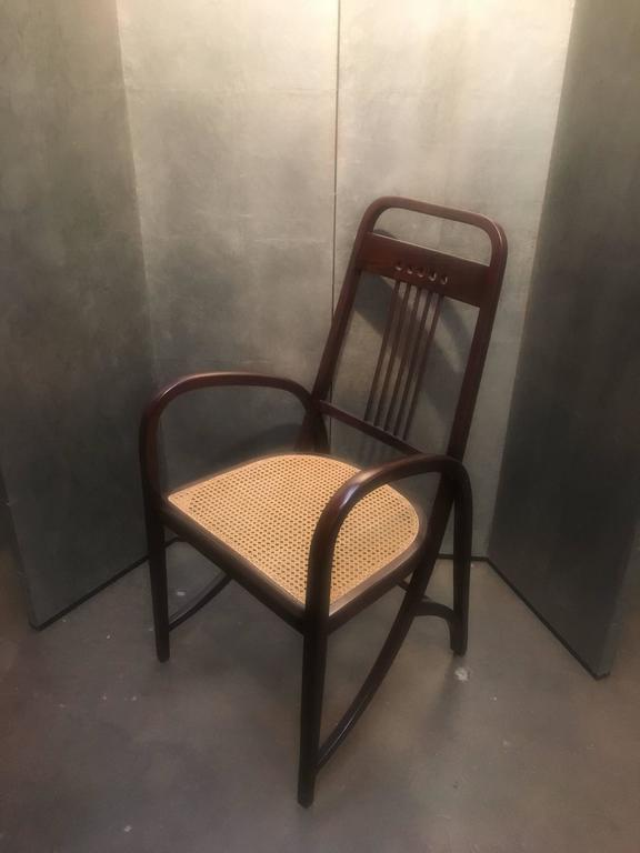 An iconic armchair of the Vienna Secession movement, the Thonet model no. 511 bent beechwood armchair, featuring stunning lines and beautiful proportions. A design tour de force, it is both simple and complex, with the legs and arms crafted from a