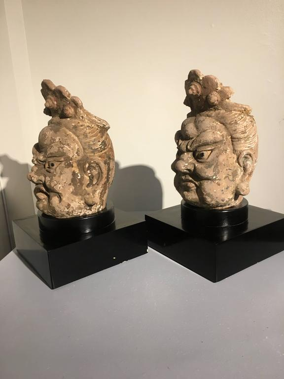 Pair of Chinese Ming Dynasty Stucco Guardian Heads In Fair Condition For Sale In Austin, TX