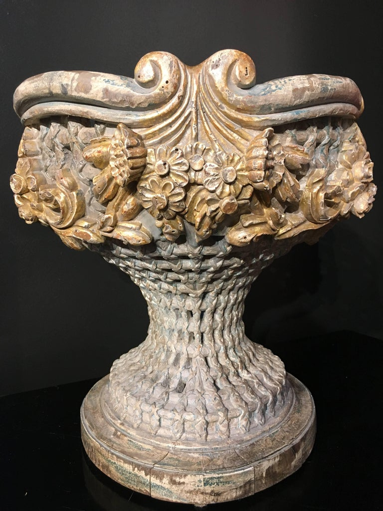 A finely carved Italian Empire Revival, polychromed and giltwood jardiniere or centerpiece, dating to circa 1900. The wooden vessel of gracious and elegant form, meticulously carved and reticulated to mimic a woven basket, with lush garlands of