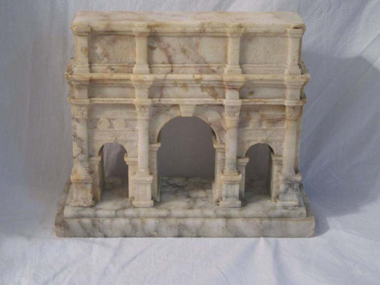 "A very fine Grand Tour model the Arch of Constantine in carved alabaster. The model sits on a Carrara marble base which is marked ""ARCO DI COSTANTINO""."