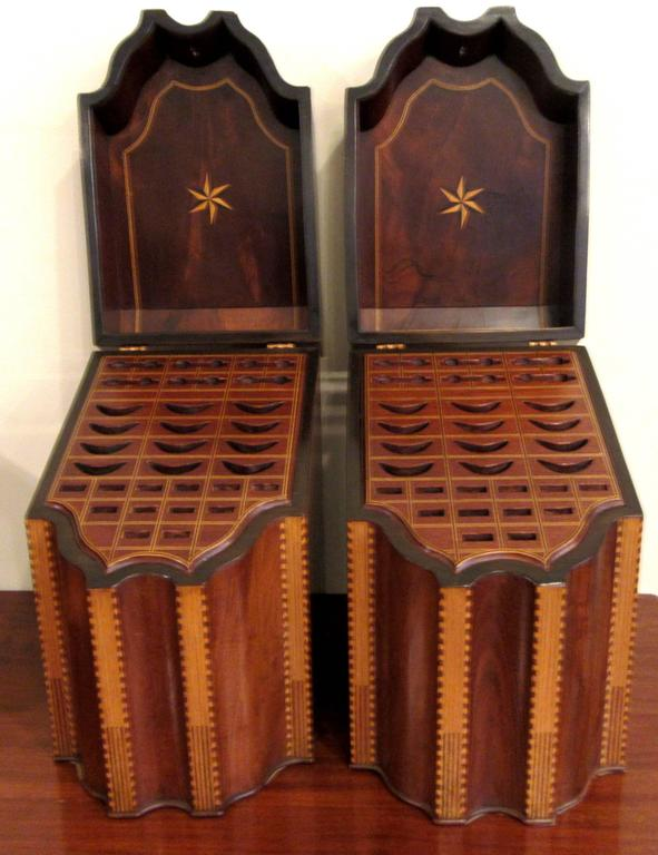 A stunning bookend pair of slant top, serpentine form knife / cutlery boxes with inserts. Inlaid banding, shell and star detail.