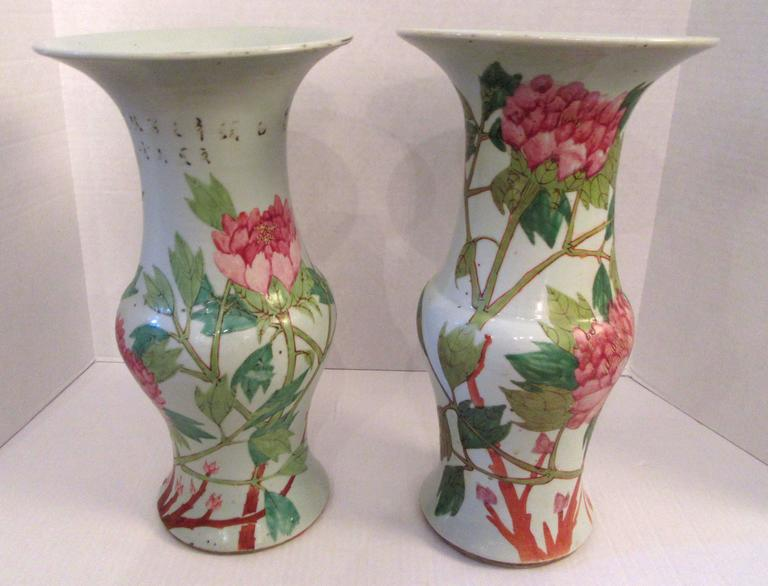 An associated pair of Chinese porcelain temple vase hand decorated with a pairs of Java rice finches on a branches. About the circumference large pink peony blossoms arise above leafy stems. The vase is considered to be from the Qing dynasty,