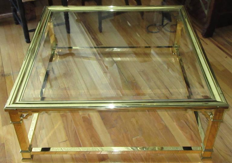 A 1970s square coffee or cocktail table with corner detail. Clear beveled glass top.