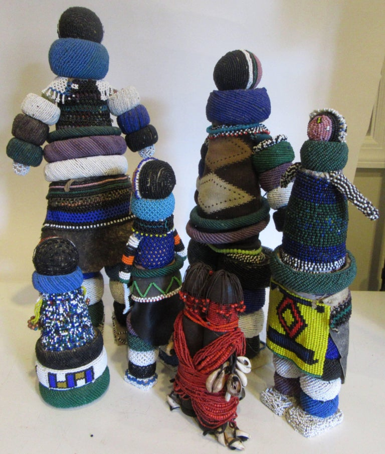 A group of six collected Ndebele hand beaded fertility dolls of various sizes and designs. The dolls are made in secret by the maternal grandmother of the bride and ritually presented when she moves into her new home.