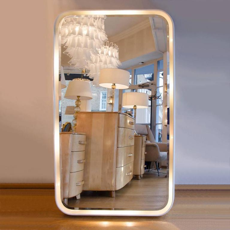 Larger than life – white laminated wall mirror with integral lighting. Can be hung vertically or horizontally.