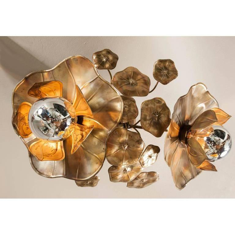 We have adapted our glamorous signature Lotus lights for the ceiling. They provide perfect mood lighting either singly or in clusters. Made in solid brass and soldered with silver, each piece is unique and individually handcrafted. Exclusive to