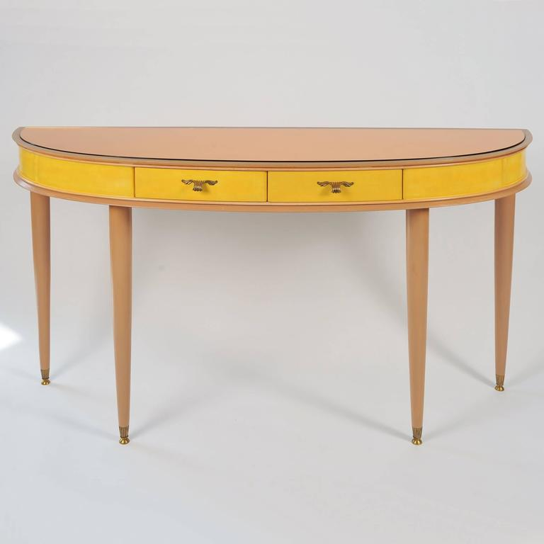 Painted fruitwood two-drawer sideboard or vanity-table on elegant tapered circular legs, with peach glass effect on top surface; the drawers and main body painted in a vivid yellow and fitted with delicate brass handles. See our separate entry for