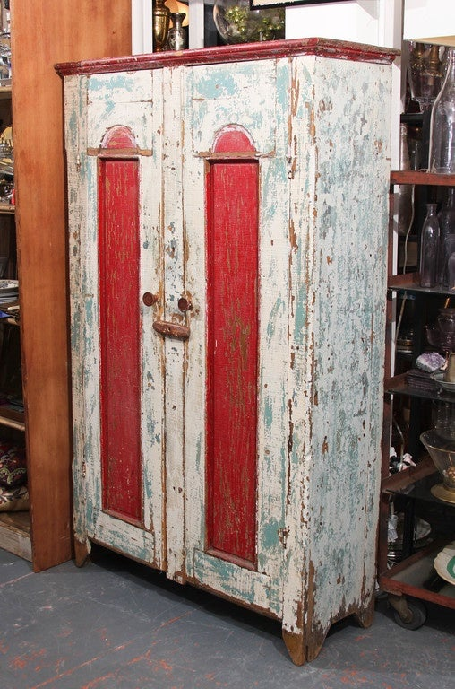 Antique cabinet from American Midwest in great old paint. Shelves inside are perfect for storing clothing , kitchen items or anything else you want close at hand but hidden from view.