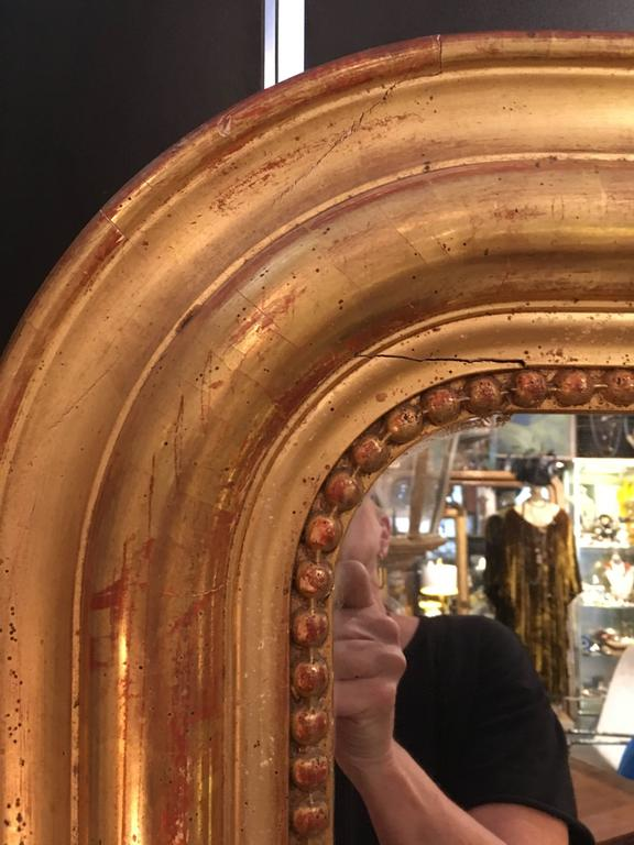 Large gilt frame Louis Phillipe floor or wall mirror. Beautiful patina and good mirror surface, France, 19th century.