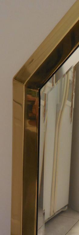 Eight sides mirror made of brass-plated frame, beveled mirror.
