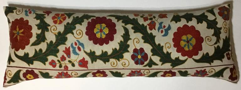 Beautiful pillow made of hand embroidery silk on cotton background colorful motifs of vines and flowers silk backing, down and feather insert.