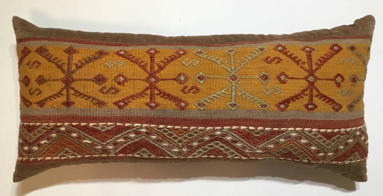 Beautiful pillow made of handwoven Kilim rug fragment, interesting geometric motif on soft muster and solomon colors. Sides and backing made of fine linen, frash insert.
