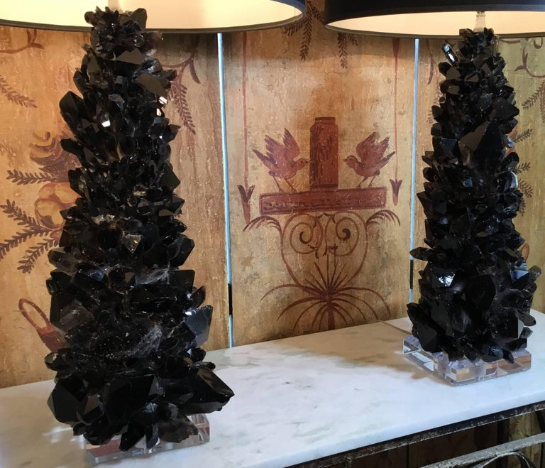 One of a kind pair of table lamps made of large and smaller genuine Quartz Crystal pieces, artistically put together to make an impressive pair of lamps. Lucite base size: 6