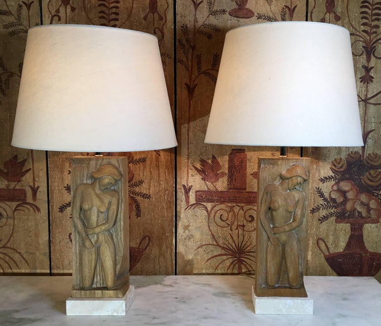 Elegant pair of lamps with hand carve wood of a pretty women, professionally mounted on a Genuine Natural coral base. Electrified and ready to light. Shades are not included. Size without the shades from the bottom of the base to the top of the