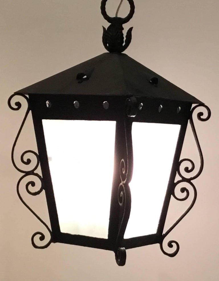 Vintage Hanging lantern made of forged iron in the Architectural style of palm beach Mizner, Milk color glass ,newly electrified with two 60/watt lights ,ready to hang and use.