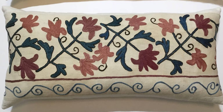 """Beautiful pair of pillows made of hand embroidery Suzani textile, colorful embroidery of vine and flowers motifs, on a handwoven crème color background. Linen trimming, silk backing, frash inserts. Sizes 26"""" x 12"""". 27""""x 12""""."""