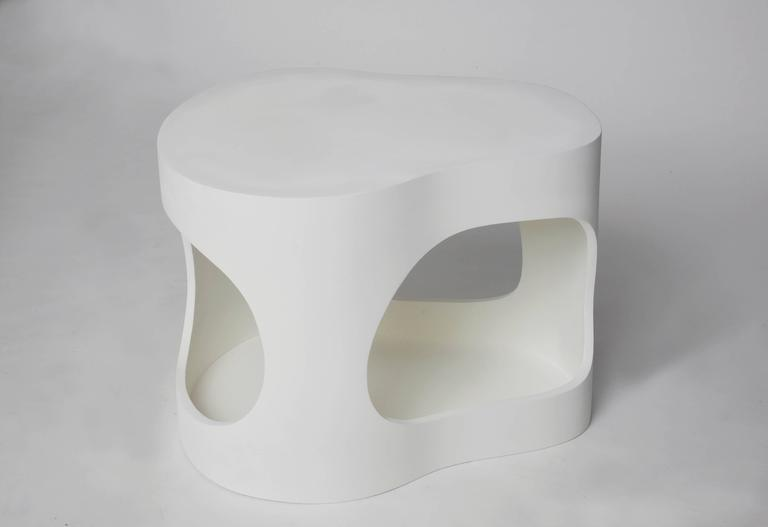 A pair of sculpted side tables shown here white on white but they can be commissioned in custom colors both for the inside and the outside. Jacques Jarrige is a contemporary artist living in Paris. With the juxtaposition of positive and negative