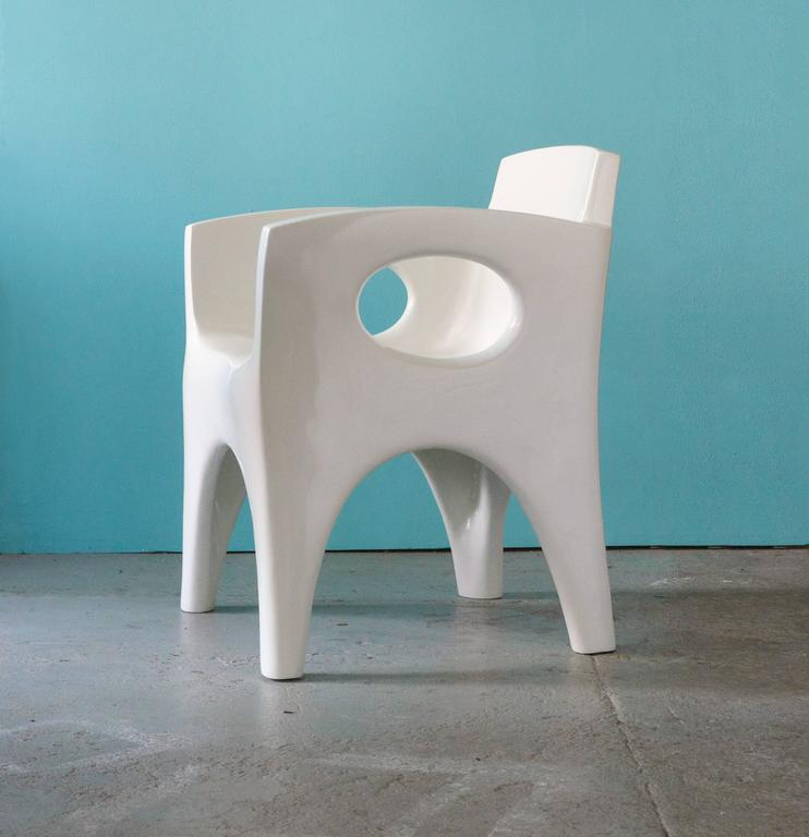 Sculpted armchairs that carry the imprint of Jarrige's joyous exploration of voids and solids.