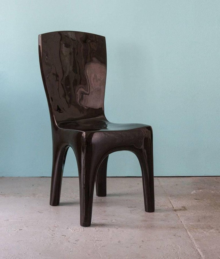 Dining chairs in lacquer by Jacques Jarrige. The sculpted chairs can also be used as desk or side chairs. Set of four available, more can be ordered. These chairs also exist in white.   Jacques Jarrige is a contemporary French sculptor and