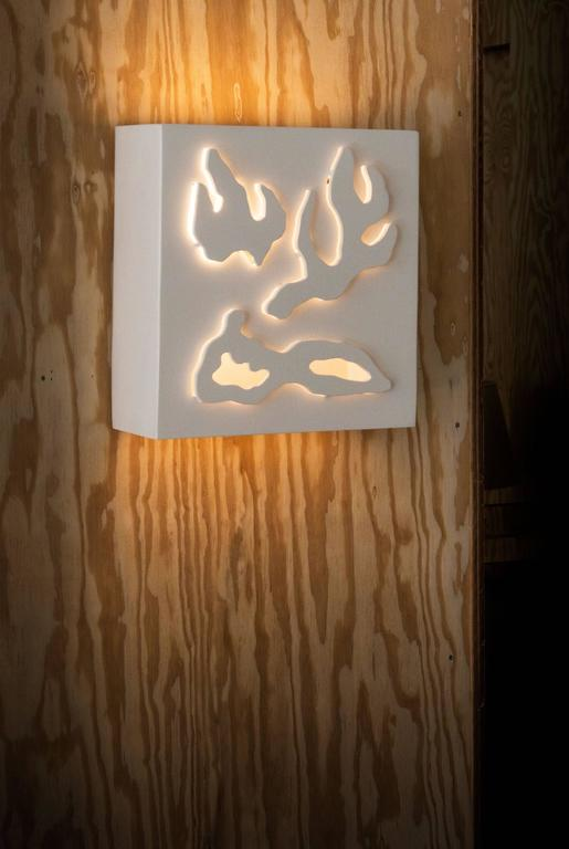 Hand cut lacquered wood sconce, wall light sculpture or table light by Jacques Jarrige. Each one is hand cut by the artist.