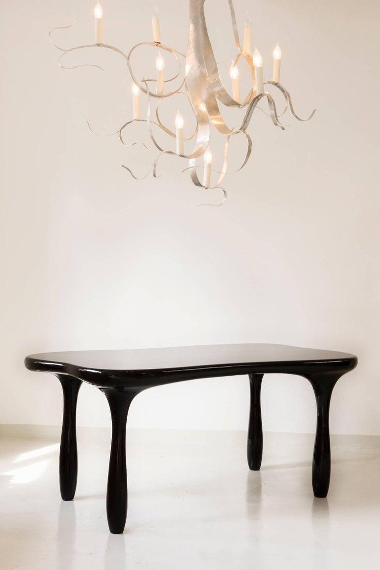 Elegant, sculpted desk or dining table by Jacques Jarrige.
