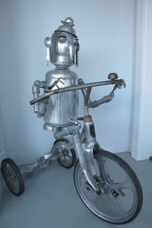 Jim Bauer is a self taught artist who creates compelling Robots and figures from all manner of aluminum objects that he has collected. This is one of his most 